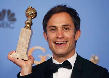 """Actor Gael Garcia Bernal poses backstage with the award for Best Performance by an Actor in a Television Series - Musical or Comedy for his role in """"Mozart in the Jungle"""" at the 73rd Golden Globe Awards in Beverly Hills, California January 10, 2016.  REUTERS/Lucy Nicholson"""