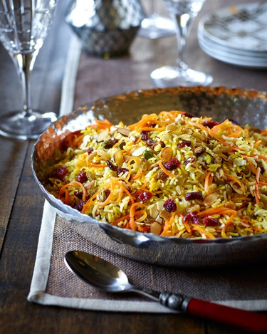 JEWELLED PERSIAN RICEIngredients:3 Tbsp. (45 mL) sugar 2 Tbsp. (30 mL) water 2 cups (500 mL) julienned or shredded carrots Zest strips of 2 oranges, julienned 2 cups (500 mL) basmati rice 1 tsp. (5 mL) saffron 1/4 cup (60 mL) vegetable broth 1 Tbsp. (15 mL) olive oil 1 small onion, diced 1/4 tsp. (1 mL) cardamom 1/4 tsp. (1 mL) cinnamon 1 tsp. (5 mL) salt 1/2 cup (125 mL) dried cranberries 1/2 cup (125 mL) green or golden raisins 1/2 cup (125 mL) toasted pistachios 1/2 cup (125 mL) toasted sliced almondsMethod:In a large skillet over medium high heat, dissolve sugar with 2 Tbsp. (15mL) water; stir in carrots and orange zest. Cook until liquid has evaporated; remove from heat and set aside.Blanch rice in a large pot of boiling water for 6 - 7 minutes until tender with a hard centre. Strain and set aside. In a small bowl, stir together saffron and 1/4 cup (60mL) vegetable broth, set aside.Heat oil in a large non-stick skillet over high heat, saute onion, cardamom, cinnamon and salt until onions are softened. Stir in rice, cranberries and raisins. Reduce heat to low, drizzle saffron water over rice, do not stir and cover with a tight fitting lid. Let sit for about 10 minutes (or until tender) to finish cooking. Spoon onto a platter and top with carrot mix, pistachios and almonds. Toss together just before serving.Makes 6 servings.