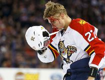 Panthers centre Nick Bjugstad (27) leaves the ice covered in blood after a fight with Edmonton defenceman Eric Gryba (62) during the first period of a NHL game between the Edmonton Oilers and the Florida Panthers at Rexall Place in Edmonton, Alta. on Sund