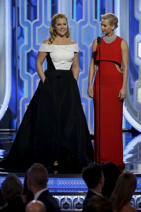 Amy Schumer (L) and Jennifer Lawrence present at the 73rd Golden Globe Awards in Beverly Hills, California January 10, 2016. REUTERS/Paul Drinkwater/NBC Universal/Handout