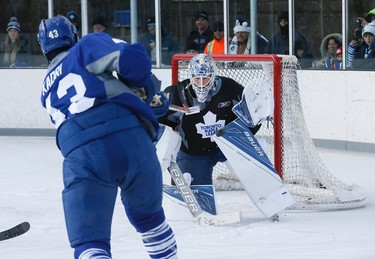 James Reimer makes a save as the Toronto Maple Leafs held their practice at Dieppe Park in East York,  Toronto on Monday January 11, 2016. Stan Behal/Toronto Sun/Postmedia Network