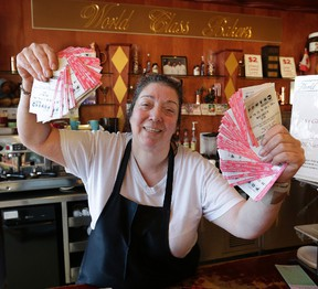 Lisa Guluzian, owner of World Class Bakers, who is giving away Powerball tickets if you buy $20 worth of baking at her store, is seen Monday, January 11, 2016. (Craig Robertson/Toronto Sun)