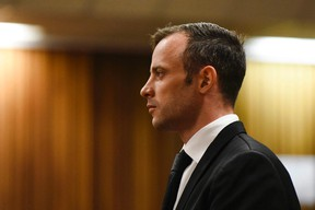 Oscar Pistorius pauses in the dock at the High Court in Pretoria, South Africa, Tuesday Dec. 8, 2015.Pistorius has appealed his murder conviction for killing girlfriend Reeva Steenkamp to South Africa's constitutional Court, a lawyer for the double-amputee Olympian said Monday. THE CANADIAN PRESS/AP/Herman Verwey, Pool