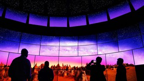 People look at an LG OLED 4K TV display at the LG booth during CES International, Thursday, Jan. 7, 2016, in Las Vegas. (AP Photo/John Locher)