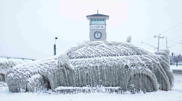 A car covered with ice remains stranded on the waterfront in Hamburg, New York January 12, 2016. The owner left his Mitsubushi Lancer parked overnight outside a restaurant on Sunday and by the next day, spray from Lake Erie had encased it in ice. REUTERS/Lindsay DeDario