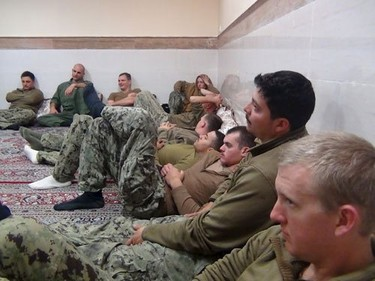 An undated picture released by Iran's Revolutionary Guards website shows American sailors sitting in an unknown place in Iran.    REUTERS/sepahnews.ir/TIMA/Handout