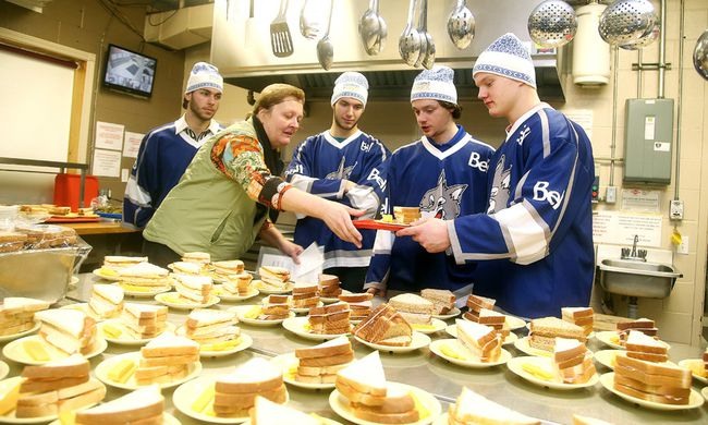 <p>Dinner captain Elizabeth Archer is handed a plate by Macauley Carson of the Sudbury Wolves at the Samaritan Centre in Sudbury, Ont. on Tuesday January 12, 2016. Looking on are team-mates Troy Timpano, Nicholas Romero and Ben Garagan. The Wolves were on hand to serve dinner and  kick-off  the 4th</p><p>annual Coldest Night of the Year winter walk event. Gino Donato/Sudbury Star/Postmedia Network