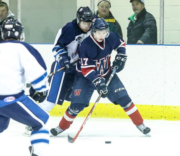 Wetaskiwin�s Matthew Klimec holds up the puck deep in the offensive zone during a game against the Morinville Jets.