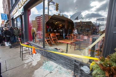 A broken front window after an incident of alleged vandalism as World Class Bakers were giving a ticket to the $1.5 billion Powerball lottery jackpot in the US with a $20 purchase in Toronto, Ont.  on Wednesday January 13, 2016. Ernest Doroszuk/Toronto Sun/Postmedia Network