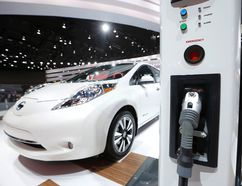 A Nissan Leaf electric car is displayed next to a charging stand at the North American International Auto Show in Detroit, January 12, 2016. REUTERS/Mark Blinch