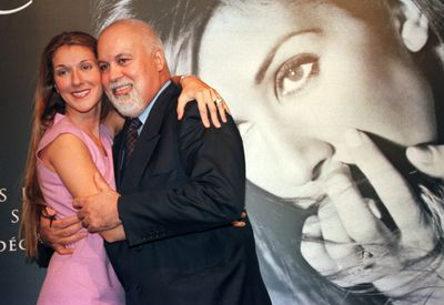 Quebec pop diva Celine Dion with her husband and manager Rene Angelil, following a press conference at the Molson Centre in Montreal, in this September 8, 1999 file photo. Angelil died January 14, 2016 at the age of 73 after a long battle with cancer, Dion said in a post on her Facebook page.   REUTERS/Staff/Files