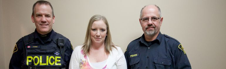 Napanee OPP constables Steve Earle, left, and Doug Weese, who were on the scene to help Candace Hawkins after her serious vehicle crash in November. (Meghan Balogh/Postmedia Network)