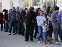 People line up for the Powerball lottery.