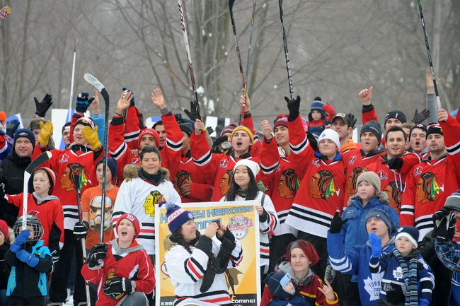 Brockville Braves players join in a community cheer during a large group photo at the Rotary pad to boost Brockville's Kraft Hockeyville bid in this January photo. (FILE PHOTO)