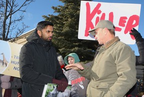 Dozens of protesters made some noise Saturday outside the Africa Show, an event that was moved last minute to the Premier Banquet Hall in Vaughan. Rather than avoid the Animal Rights Toronto demonstrators, Paul Peca waded into the crowd and did his best to defend trophy hunting. CHRIS DOUCETTE/TORONTO SUN