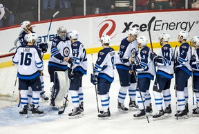 The Winnipeg Jets celebrate following a Jan. 15 game against the Minnesota Wild at Xcel Energy Center. The Jets will possibly be shorthanded due to injuries on Monday. (Brace Hemmelgarn-USA TODAY Sports)