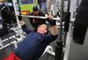 Kevin Palmer (right) works out with trainer Valentine Payne in Winnipeg. (Brian Donogh/Winnipeg Sun/Postmedia Network)