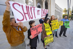 Residents and supporters stand outside Los Angeles City Hall during a demonstration ahead of the testimony before the Los Angeles City Council on the ongoing natural gas leak in the Porter Ranch area of Los Angeles, California December 1, 2015. Government and industry officials in Ontario say it's unlikely a similar event would happen in the province. (REUTERS/Gus Ruelas)