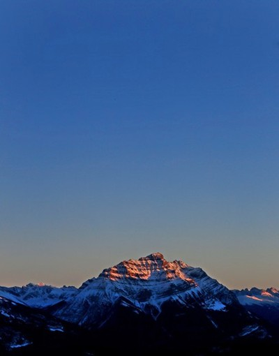A room with a view. The sun sets on a mountain range viewed from Marmot Basin's Caribou Chalet at the base of the skill hill in Jasper National Park. The annual Jasper in January festival started on Thursday 14th and runs through Jan. 31st. For daily and full schedule of planned events; www.jasperinjanuary.com Tom Braid/Edmonton Sun/Postmedia Network.