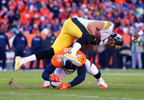 Denver Broncos outside linebacker Von Miller tackles Pittsburgh Steelers tight end Matt Spaeth during the second quarter of the AFC divisional round playoff game at Sports Authority Field at Mile High in Denver on Jan. 17, 2016. (Mark J. Rebilas/USA TODAY Sports)