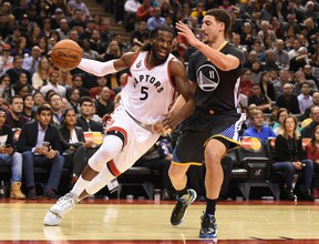 Raptors' DeMarre Carroll (left) drives against Warriors' Klay Thompson back in early December. Carroll underwent knee surgery two weeks ago and there is no set timetable for his return. (USA TODAY SPORTS/PHOTO)