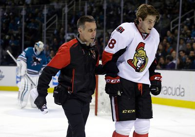 Ottawa Senators' Mike Hoffman (68) is taken off the ice after a collision with San Jose Sharks goalie Alex Stalock, left, during the second period of an NHL hockey game Monday, Jan. 18, 2016, in San Jose, Calif. (AP Photo/Marcio Jose Sanchez)