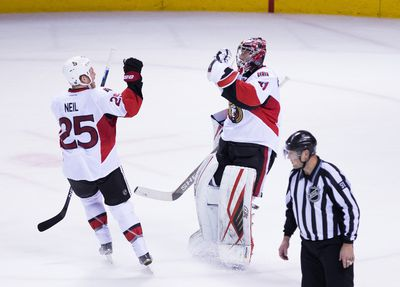 Jan 18, 2016; San Jose, CA, USA; Ottawa Senators right wing Chris Neil (25) celebrates with goalie Craig Anderson (41) after the win against the San Jose Sharks in shootout at SAP Center at San Jose. Ottawa defeated San Jose 4-3 in a shootout. Mandatory Credit: Kelley L Cox-USA TODAY Sports