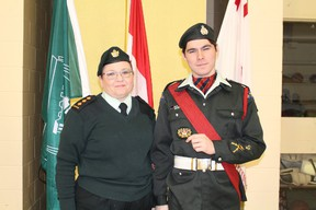 Chief Warrant Officer Patricia Nelson presented Taylor Martin his promotional badge, upgrading his rank to Master Warrant Officer.