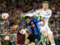 Colorado Rapids goalkeeper Clint Irwin (1) makes a save against Montreal Impact midfielder Andres Romero (15) in the second half at Dick's Sporting Goods Park. The Rapids defeated the Impact 4-1.  Isaiah J. Downing-USA TODAY Sports