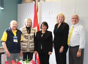 Sarnia Kiwanis Foundation's Terry North, Sarnia City Manager Margaret Misek-Evans, LKCC executive director Bev MacDougall, MP Marilyn Gladu and Golden K Kiwanis President Bob Lutz celebrate the addition of a new automatic, accessible door opener at the Lochiel Kiwanis Community Centre on Jan. 12. CARL HNATYSHYN/SARNIA THIS WEEK