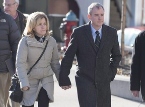 Dennis Oland and his wife Lisa head to the Law Courts where he was found guilty of second degree murder in the death of his father, Richard Oland, in Saint John, N.B. on Dec. 19, 2015. (THE CANADIAN PRESS/Andrew Vaughan)