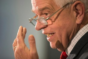 Immigration Minister John McCallum briefs journalists at the Welcome Centre in Toronto's Pearson Airport on Thursday, December 31, 2015. (THE CANADIAN PRESS/Chris Young)