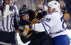 Rich Clune of the Maple Leafs (right) tussles with Zac Rinaldo of the Boston Bruins on Jan. 16, 2016, during a rare fight involving a Leafs player this season. (MICHAEL DWYER/AP)