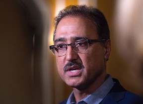 Federal Infrastructure Minister Amarjeet Sohi talks with reporters at a cabinet retreat at the Algonquin Resort in St. Andrews, N.B. on Sunday, Jan. 17, 2016. THE CANADIAN PRESS/Andrew Vaughan