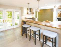 Each product in this Sarnia kitchen features certified, environmentally friendly or recycled components. The kitchen was part of a whole home remodelling project. It was named the 2016 Green Design Winner, North American wide competition and HGTV.com people's choice award. (Designer: Cassandra Nordell/Copyright William Standen Co. 2016)