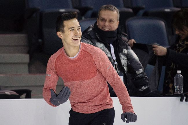 Patrick Chan laughs with his coaches during a practice session at the Canadian Figure Skating Championships in Halifax on Thursday, January 21, 2016. THE CANADIAN PRESS/Darren Calabrese