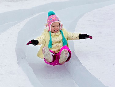 Trinity Riley, 5, enjoys an ice slide during the opening day of the 2016 Ice On Whyte Festival at the End of Steel Park, in Edmonton Alta. on Thursday Jan. 21, 2016. Photo by David Bloom