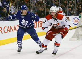 Maple Leafs defenceman Morgan Rielly (44) keeps his eye on Carolina Hurricanes forward Eric Staal during the first period at the Air Canada Centre on Thursday. (John E. Sokolowski-USA TODAY Sports)
