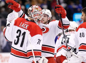 Hurricanes goaltender Eddie Lack is congratulated following his 32-save shutout over the Maple Leafs on Thursday night at the ACC. (USA TODAY SPORTS/PHOTO)