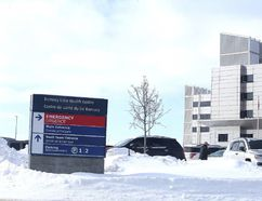 A sign points to the parking lot at Health Sciences North on January 18, 2016. (Gino Donato/Sudbury Star)
