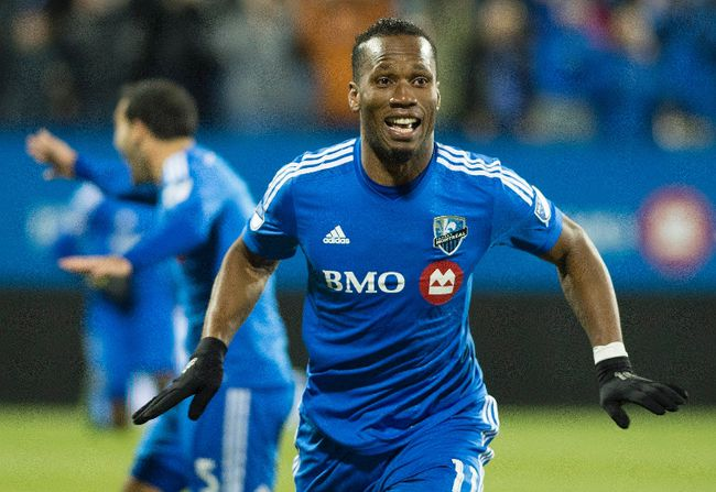 Montreal Impact's Didier Drogba celebrates after scoring against Toronto FC during first half MLS playoff soccer action in Montreal, Thursday, October 29, 2015. THE CANADIAN PRESS/Graham Hughes