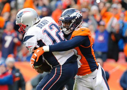 New England Patriots quarterback Tom Brady (12) is tackled by Denver Broncos outside linebacker Von Miller (58) in the third quarter in the AFC Championship football game at Sports Authority Field at Mile High. Kevin Jairaj-USA TODAY Sports