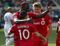 Toronto FC midfielder Sebastian Giovinco (10) celebrates his goal with forward Jozy Altidore (17) and defender Nick Hagglund (6) during the first half against the Philadelphia Union at PPL Park. Bill Streicher-USA TODAY Sports