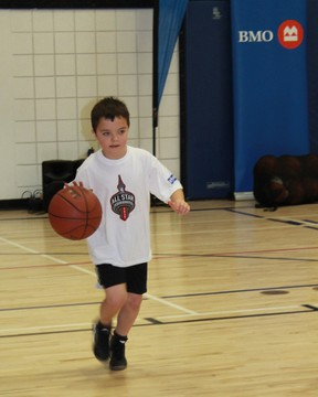 A young basketball player practices his dribbling skills during the BMO NBA All-Star KidsFest, which came to Sarnia on Sunday, Jan. 13. CARL HNATYSHYN/SARNIA THIS WEEK