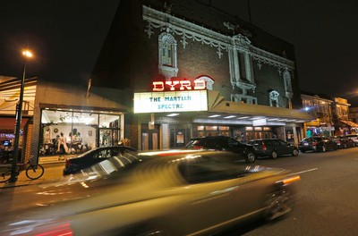 In this Jan. 20, 2016 photo, traffic passes by the Byrd Theater in Carytown a few miles west of downtown Richmond, Va. The Byrd Theatre is an 88-year-old movie palace that shows second-run movies for $2 a ticket. (AP Photo/Steve Helber)