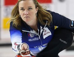 Skip Chelsea Carey delivers a shot during her match against the Val Sweeting rink at the 2016 Jiffy Lube Alberta Scotties Tournament Of Hearts at Northhill curling club on Sunday, January 24, 2016, in Calgary, Alta. Al Charest/Postmedia