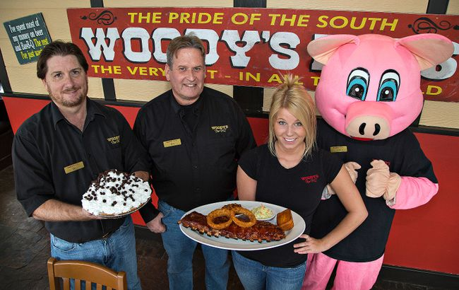Woody's Canada president Dan Masters (left) joins Brantford franchise owner Mike Bell, manager Brittany Middleton and mascot Percy on Wednesday at the newest location in the chain on King George Road. (Brian Thompson/the Expositor)