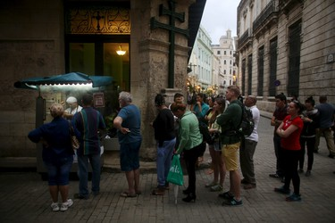 Cuba's tourism industry is under unprecedented strain to meet demand with record numbers of visitors after restoring diplomatic ties with the United States.Tourists and Cubans line up for fried doughs in old Havana in this January 13, 2016 picture. REUTERS/Alexandre Meneghini