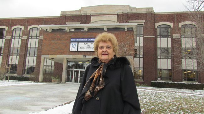 Allison Rowell stands on Wednesday January 27, 2016 in Sarnia, Ont., in front of Sarnia Collegiate Institute and Technical School. As a student in the 1950s, Rowell wrote The SCITS Song. (Paul Morden, The Observer)