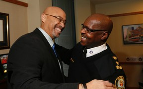 Toronto Police Chief Mark Saunders, on a day when four of his officers were charged with obstruction, helps celebrate the retirement of Const. Donny Moss on Thursday, January 28, 2016. (Stan Behal/Toronto Sun)